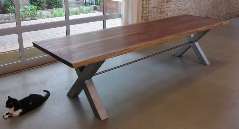 Reclaimed black walnut wood dining table by moss design