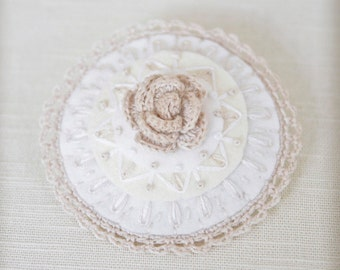 pale embroidered felt brooch with flower and lace trim