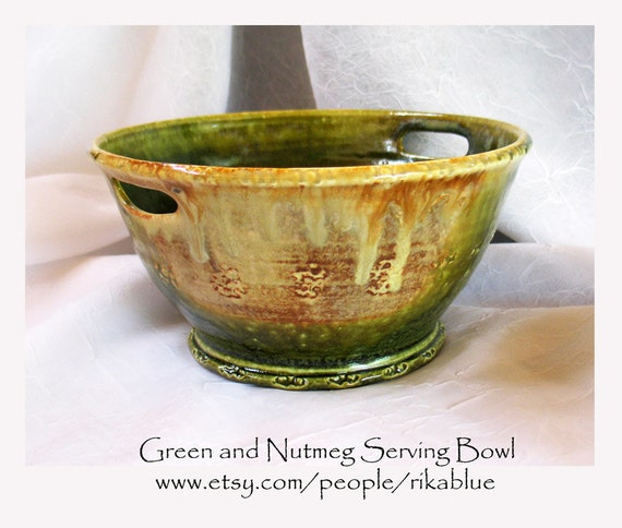 Green and nutmeg pottery bowl with handles