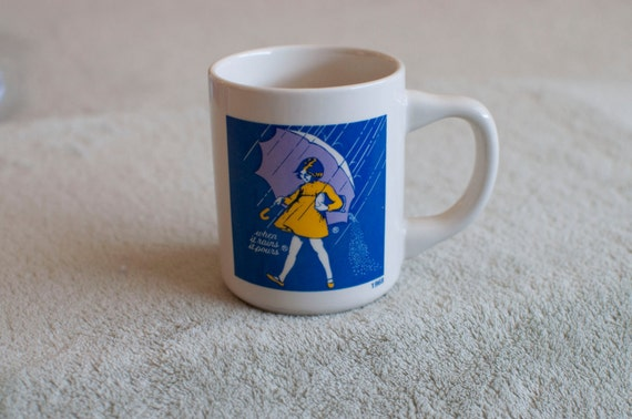 1968- When it rains it pours vintage Mortons Salt girl mug