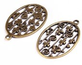 2 butterfly pattern oval charm pendants antique brass antique bronze 2pcs (551) - Flat rate shipping