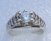 Sterling silver, gents six prong ring with cubic zirconia and decorated sides