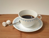 Cup and saucer set in delicate blue and white pattern