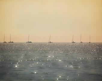Nautical photo, sailboats, golden sky horizon, shimmering ocean seascape, beige peach boats boating sailing, calm zen minimalist decor