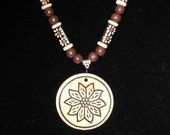 Wood and Carved Bone Pendant Necklace