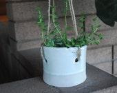 white hanging plant pot