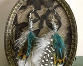 White, gold, turquoise, green and peacock feather earrings. Style: Ricci