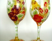 Hand painted wine glasses with purple and red roses. Set of 2.