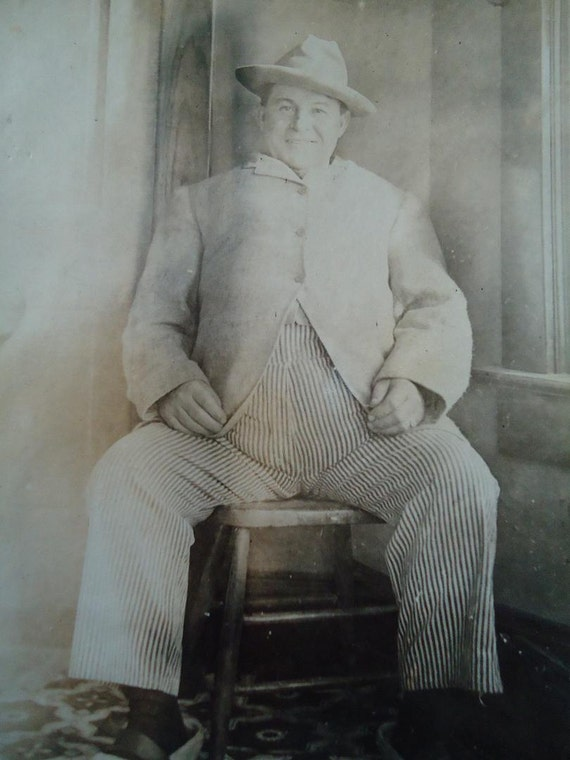 Vintage Black and White 1920s Photo of a Strange Man Wearing big Slippers
