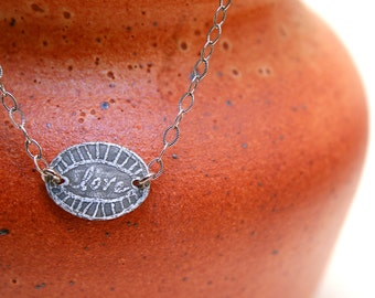 Etched love necklace