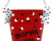 Metal powder coated 5 Qt. buckets personalized with vinyl in your choice of colors.