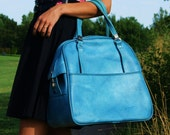 American Tourister Large turquoise worn leather carryall