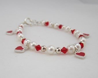 Baby Bracelet White Pearls and Red Crystals with Red hanging hearts (BRH)