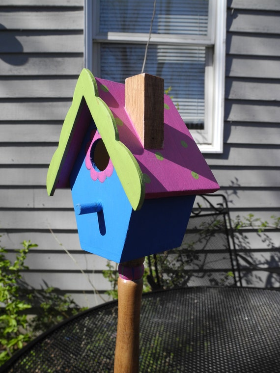 Vibrant Spring time colored decorative wooden birdhouse