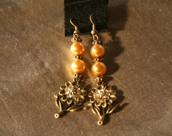 Lovely crystal flowers with golden glass pearls