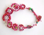 Pink crochet necklace with wooden beads, fabric buttons and satin roses, OOAK