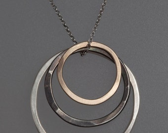 3 Ring Necklace in Sterling Silver, Oxidized Silver and Gold