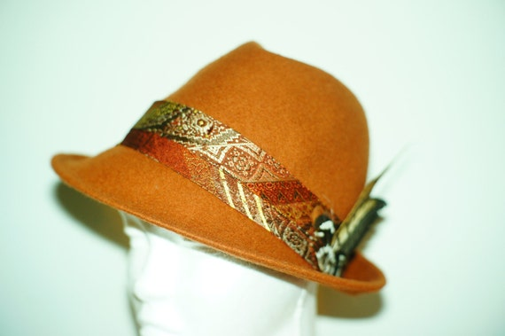 One-of-a-kind reddish-brown wool fedora adorned with beautiful vintage fabric and lovely pheasant feathers