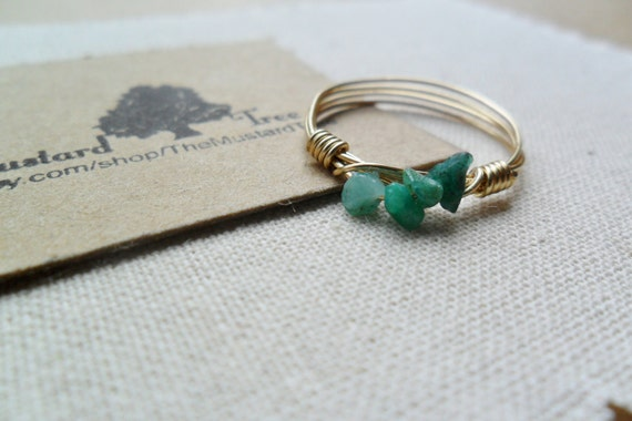 Row of small green rough emerald gemstone chips gold wire wrapped ring