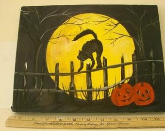 Halloween cat in the dark
