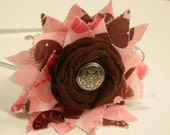 Pink and Brown Ribbon Bunting with Rolled Fabric Flower and Metal Button Center, All on a Silver Metal Headband.