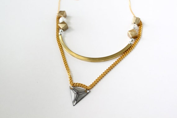 CosmicWonder, geometric necklace with triangles, in gold with metal arch tube and vintage beads