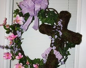 Beautiful Easter grapevine wreath with moss covered Cross