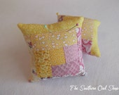 Yellow and pink log cabin quilt block pin cushion