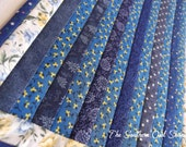 Medium size scrappy doll quilt - blue and yellow floral prints