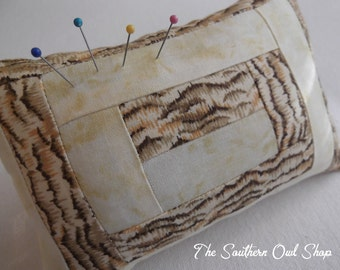 Brown and yellow-beige animal print quilt block pin cushion