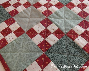 Green, red and white checker board pattern small quilt