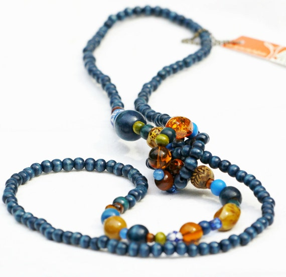 Long beaded necklace, long wood necklace, rope, knot, dark blue, sodalite blue, amber, pantone fashion colours.