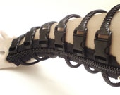 Black cuff, steampunk fashion zipper jewelry, weird fingerless gloves.