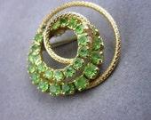 Vintage Pin Spiraling Green Rhinestones