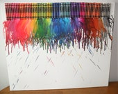 Bleeding Crayon Art on Canvas, made by my 4 yr old son. great addition to any kids room