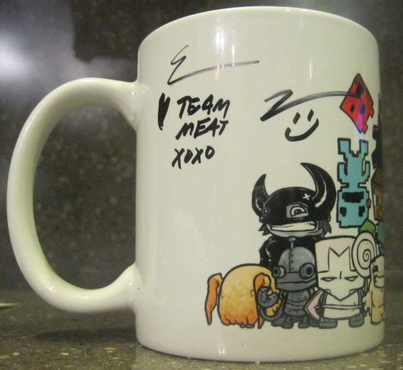 "Limited edition mug, Super Meat Boy ""The Team"" signed & numbered."