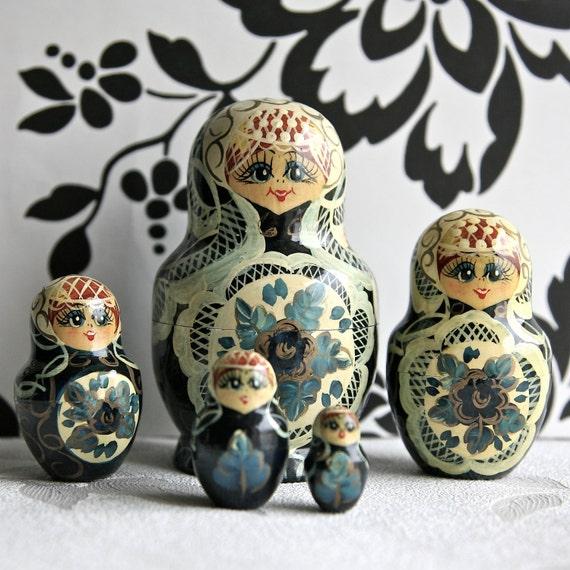 Russian/Matryoshka wooden dolls, set of five beautifully painted
