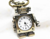 robot pocket watch keychain with the arms can move and a handgun charm
