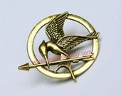 brooch---The Hunger Games pendant ,Inspired Mockingjay brooch with a pin at the back (brass)