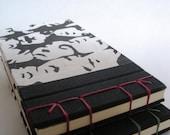 Face Print Coupon Book (red binding)