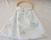 Blue floral fabric purse, with wood circle handles, gathered fabric purse