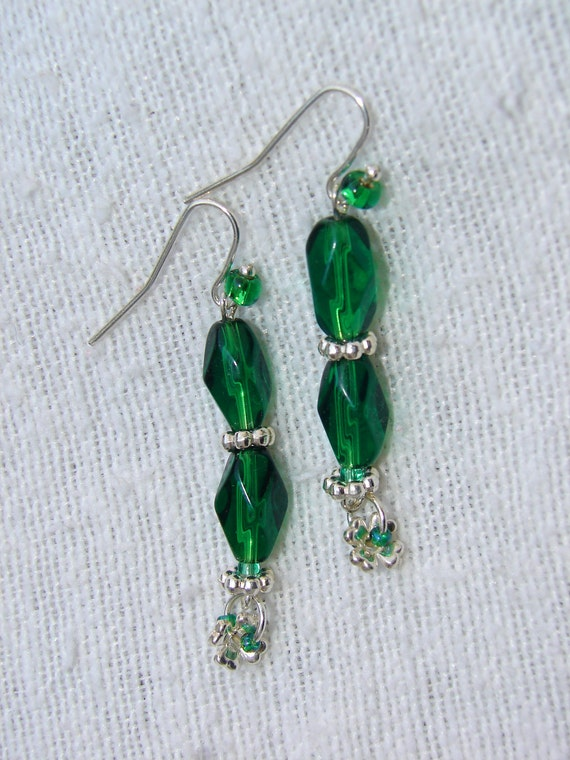 items similar to pierced earrings emerald green faceted