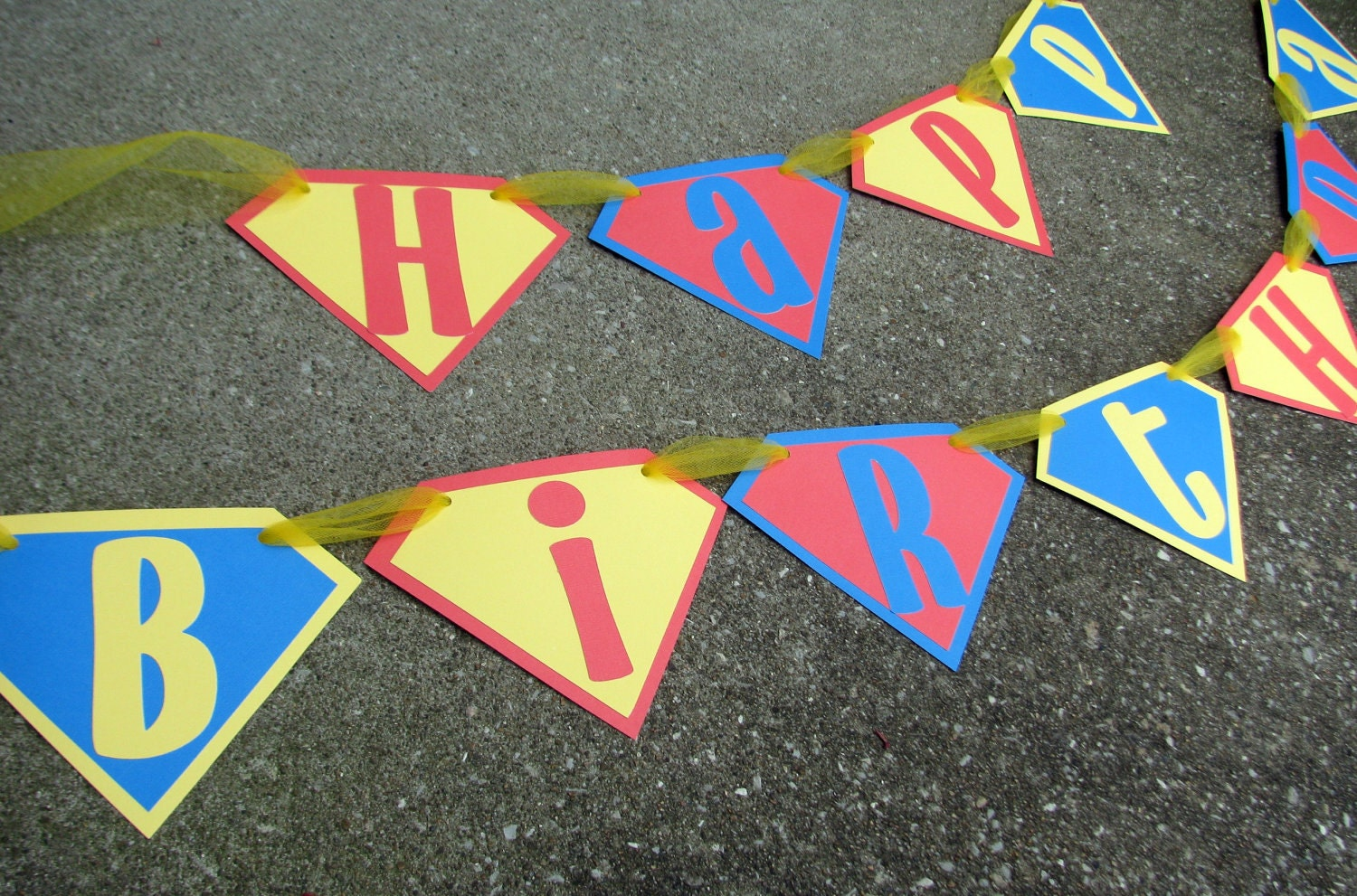 superman happy birthday banner in red blue and yellow for