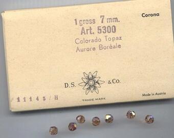36 pieces vintage Swarovski Art. 39/5300 - 7 mm - colorado topaz AB