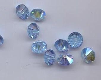 Twelve vintage Swarovski crystal beads: Art. 5307 - 10 mm - aqua AB
