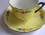 Vintage teacup and saucer - Yellow with daisies and black edge - Czechoslovakia
