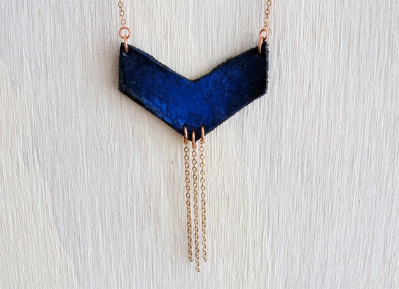 Hand painted leather necklace. Deep blue chevron with three dangles.