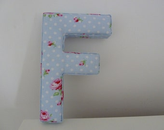 """Blue floral padded wall letter """"F""""."""