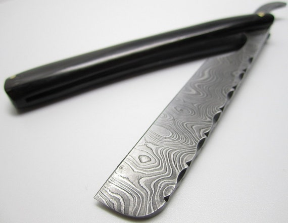 "handmade Damascus straight razor with filework on the back of the 3"" blade, polished black buffalo horn 5"" handle"