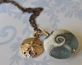 ocean wave lampwork bead with golden bronze sand dollar necklace